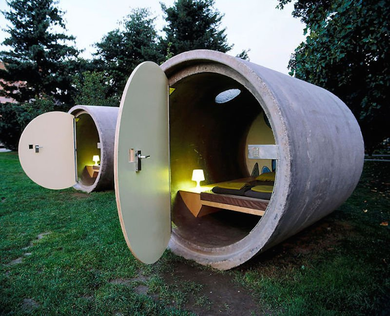 not exactly a house but this small round concrete thing is actually a hotel room at a hotel called das park hotel located in both austria and germany
