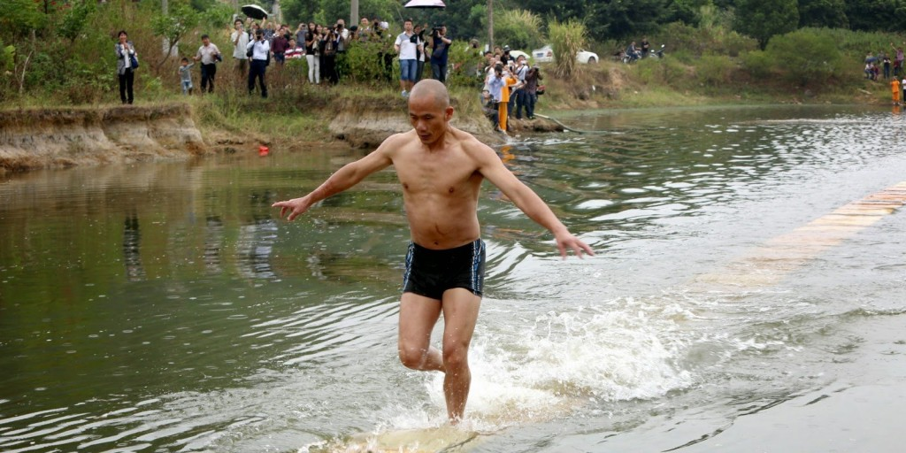 Shaolin Monk Runs On Water Using Nothing But Planks Of Wood