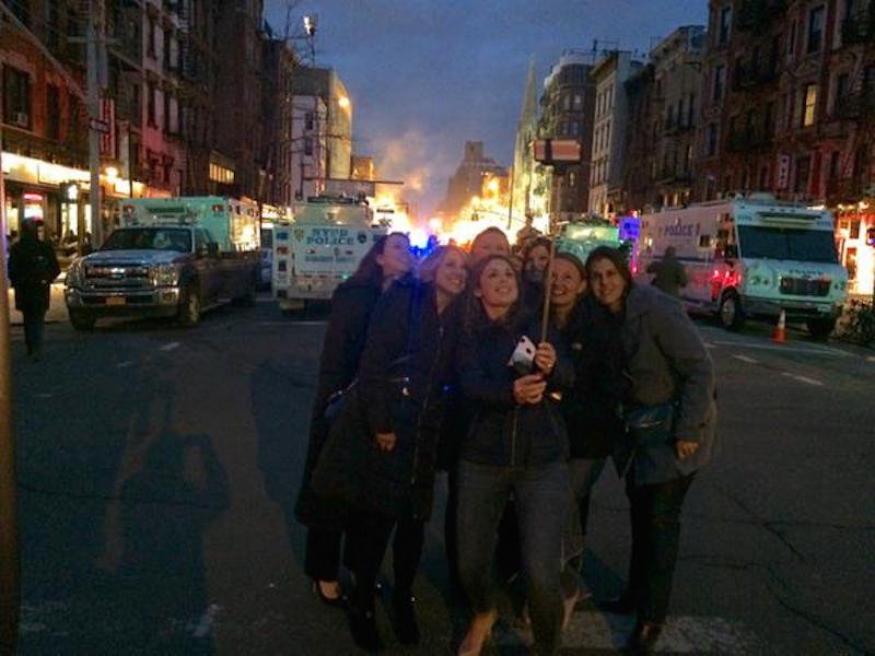 Women Take Selfie While Buildings Burn Behind Them In NYC